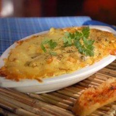 Receta de pescado con mariscos y salsa de queso